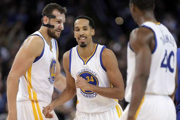 Shaun Livingston (34) is congratulated by Andrew Bogut (12) and Harrison Barnes (40) after he hit a slam dunk in the second half as the Golden State Warriors played the Detroit Pistons at Oracle Arena in Oakland, Calif., on Monday, November 9, 2015.