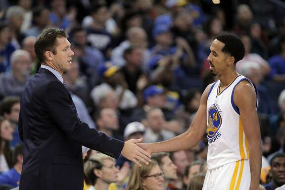 Interim head coach Luke Walton high fives Shaun Livingston (34) as he comes off the court in the second half as the Golden State Warriors played the Detroit Pistons at Oracle Arena in Oakland, Calif., on Monday, November 9, 2015.