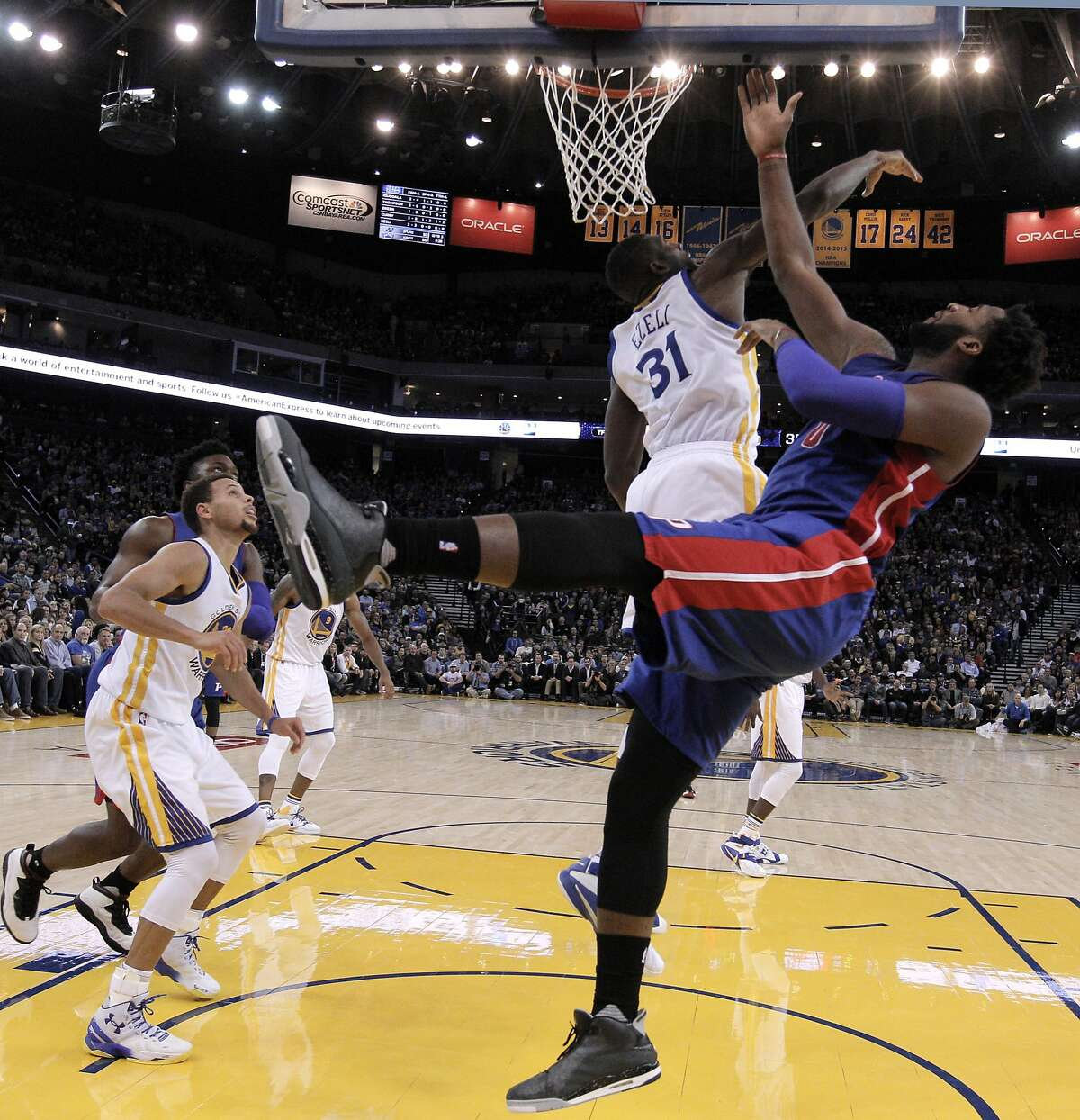 Festus Ezeli (31) defends against a shot by Andre Drummond (0) in the first half as the Golden State Warriors played the Detroit Pistons at Oracle Arena in Oakland, Calif., on Monday, November 9, 2015.