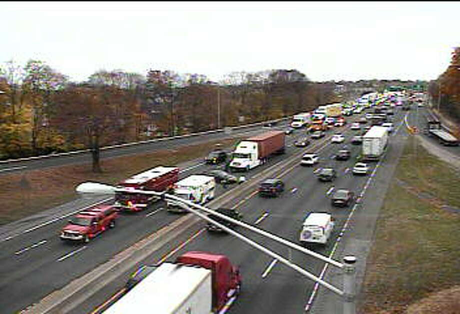 A tractor-accident involving several vehciles has shut down the left and center lanes on I-95 in Norwalk on Tuesday, Nov. 10, 2015. Photo: /
