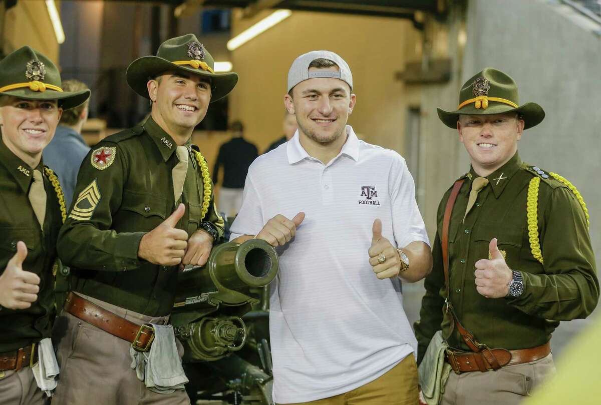 COLLEGE STATION, TX - NOVEMBER 07: Former Texas A&M Aggies quarterback Johnny Manziel poses with some cadets at Kyle Field on November 7, 2015 in College Station, Texas.