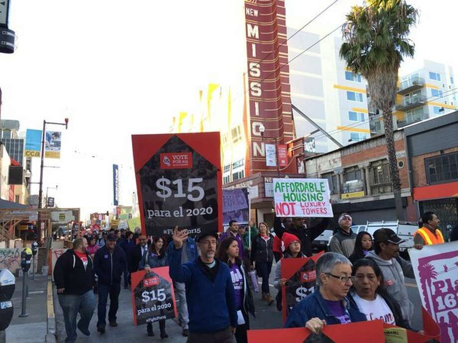Fast food workers in the Bay Area and across the nation united for a protest Tuesday -- a one-day event calling for a raise to the minimum wage  to $15 an hour. Hundreds of demonstrators gathered at this McDonald's on Mission and 24th Streets before staging a march and voicing their demands. Photo: Evan Sernoffsky