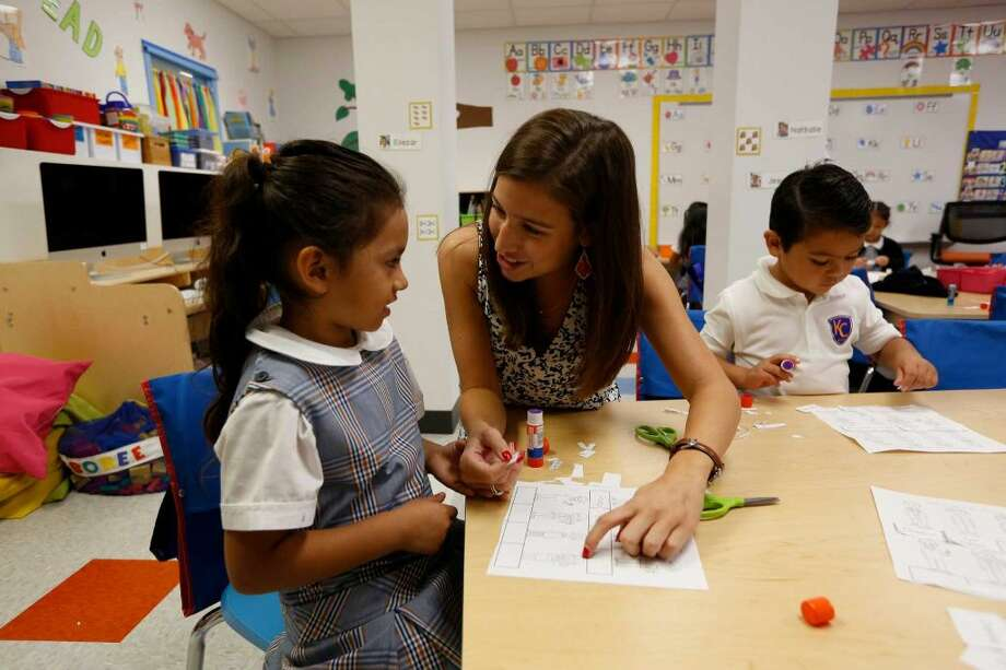 Rather than polarizing choices, we could commit  to increasing the availability of great schools in all neighborhoods. In this photo: Alexis Ríos helps Flor Perdomo at a Kipp school in Houston. Photo: Steve Gonzales, Houston Chronicle