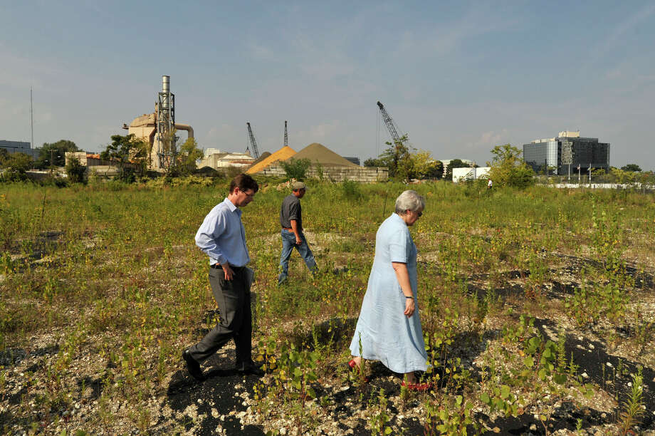 From left: John Freeman, vice president and general counsel of Building and Land Technology; William Buckley Jr, engineer with BLT; and Janice Deshais, hearing officer with DEEP, walk during a tour of a Building and Land Technology-proposed boatyard between the west side of the West Branch of Stamford Harbor and Southfield Avenue in Stamford, Conn., on Tuesday, Sept. 8, 2015. Photo: Jason Rearick / Hearst Connecticut Media / Stamford Advocate