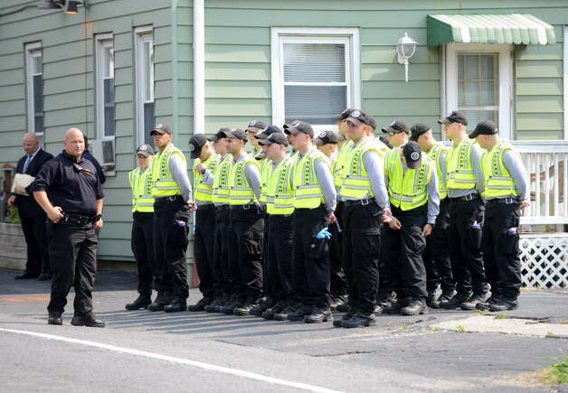 State Police recruits wait for their transport after searching for clues in the killing of local hair stylist Jacquelyn Porreca Monday morning, Aug. 31, 2015, in Colonie N.Y. Porreca, 32, was stabbed to death on Aug. 21 inside Recycled Salon on Sand Creek Road. Police said cash was stolen from several places inside the salon. (Will Waldron/Times Union) Photo: WW