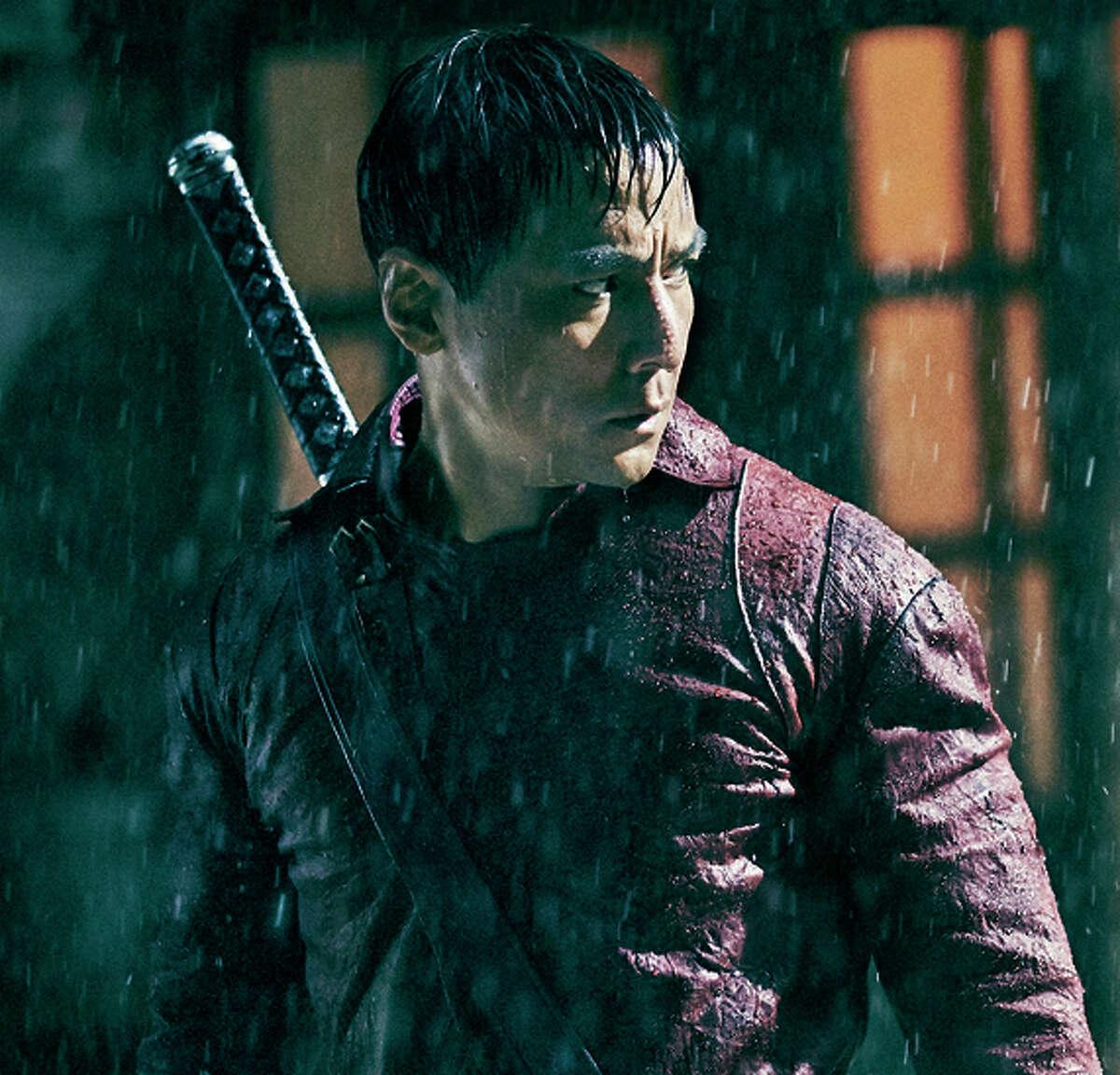 "Left: Daniel Wu is coldhearted killer Sunny in ""Badlands."""