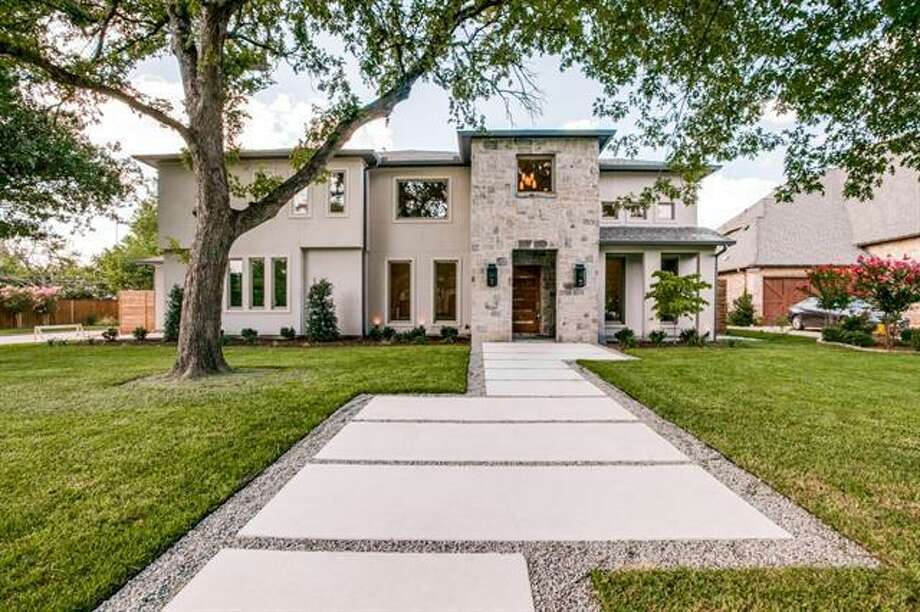 Dallas Mavericks point guard J.J. Barea bought this home in the Preston Dell Estates for $1.6 million. The five-bedroom, 5.5-bathroom home was built by Ken Ellefson of Lm2Group and listed by Stevie Chaddick from Coldwell Banker. Photo: Courtesy, Stevie Chaddick/Coldwell Banker.