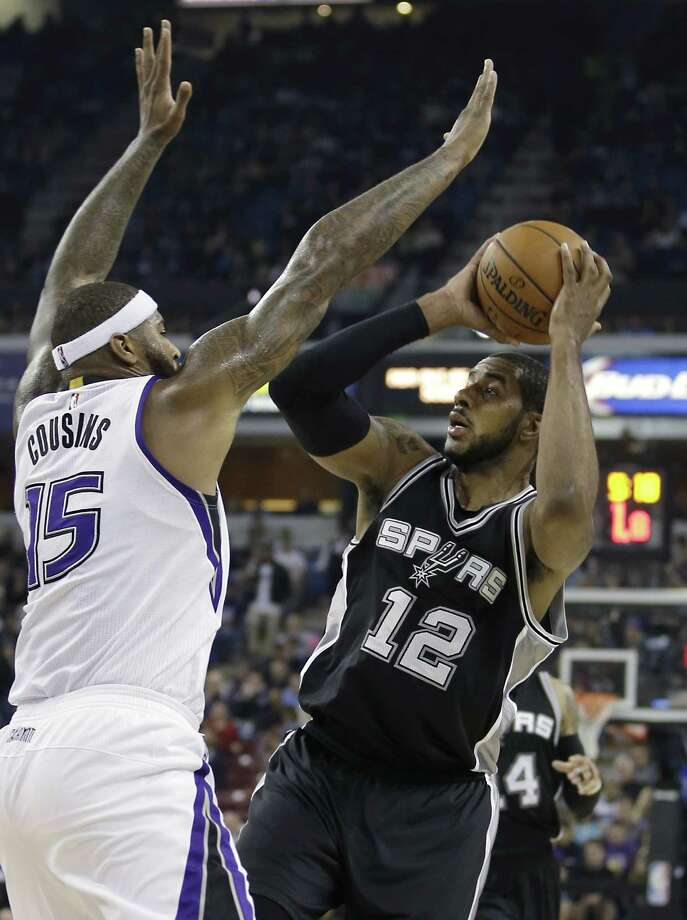 Sacramento Kings forward DeMarcus Cousins, left, tries to block the shot of San Antonio Spurs forward LaMarcus Aldridge, during the first half of an NBA basketball game in Sacramento, Calif., Monday, Nov. 9, 2015. (AP Photo/Rich Pedroncelli) Photo: Rich Pedroncelli, STF / Associated Press / AP
