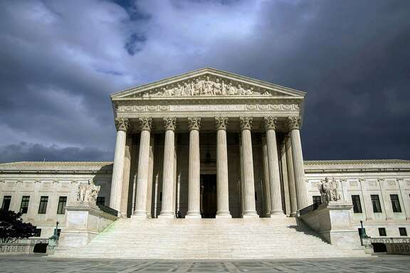 (FILES) In this March 31, 2012 file photo, the US Supreme Court Building is seen in Washington, DC.  President Barack Obama's administration on November 10, 2015 asked the Supreme Court to uphold White House measures shielding up to four million undocumented migrants from deportation. Thrusting the country's top court into the role of arbiter in a emotionally charged political debate, the Justice Department said it would challenge lower court rulings that blocked Obama's efforts to reform immigration policy.