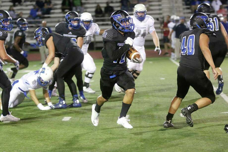 Friendswood #12 Nick Dehoyos runs to safety after intercepting a touchdown pass. Photo by Pin Lim. Photo: Pin Lim, Freelance / Copyright Forest Photography, 2015.