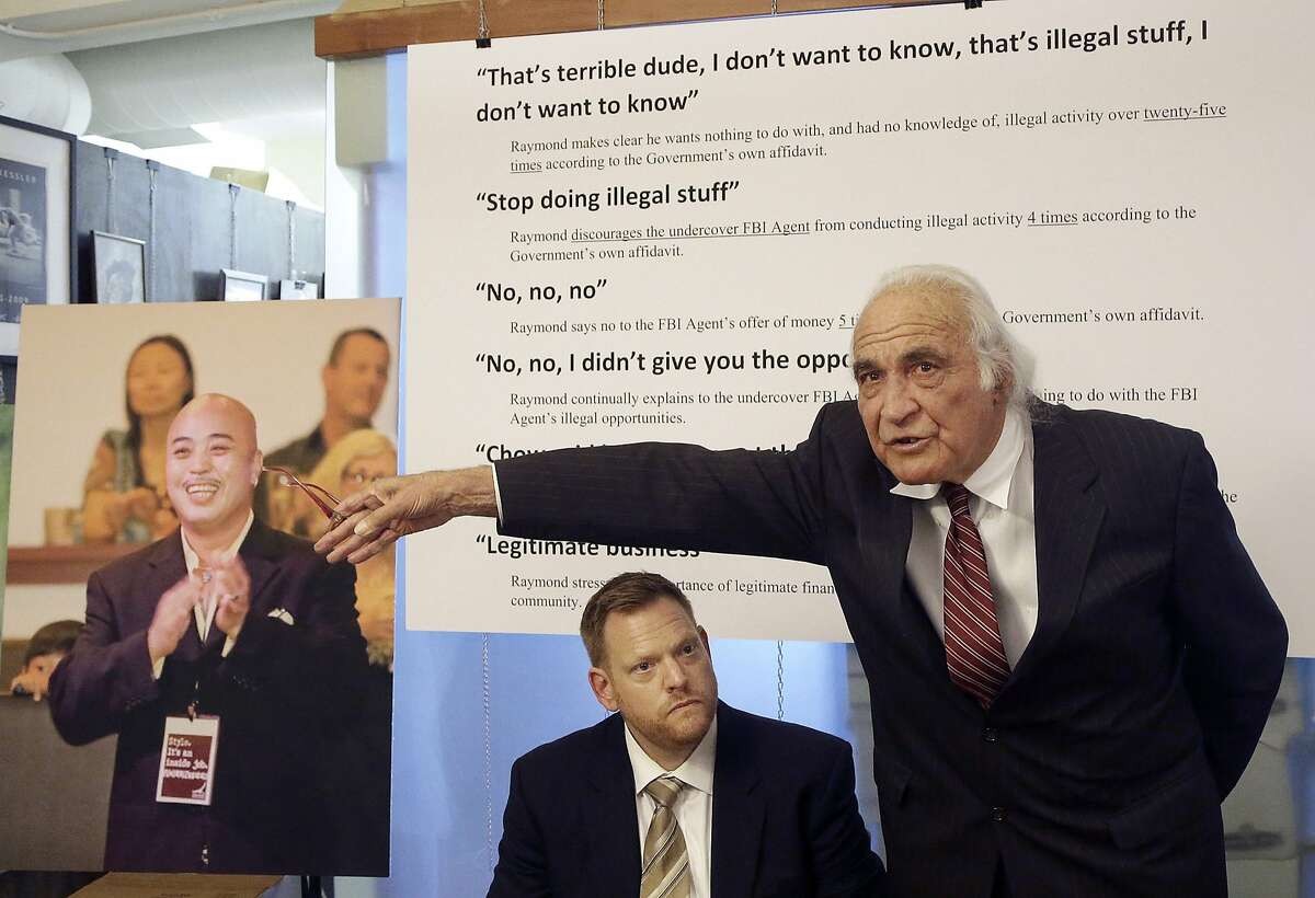 """FILE - In this April 10, 2014 file photo, Tony Serra, right, speaks next to Curtis Briggs, both attorneys for Raymond """"ShrimpBoy"""" Chow, pictured at left, during a news conference in San Francisco. Chow, a dapper former San Francisco gang leader who portrayed himself as a reformed criminal, was the focus of a lengthy organized crime investigation in Chinatown that ended up snaring a corrupt California senator and more than two dozen others. With opening arguments in Chow's scheduled Monday, prosecutors finally will get their chance to convict him of racketeering, murder and money laundering charges that could put him away for life. (AP Photo/Jeff Chiu, File)"""