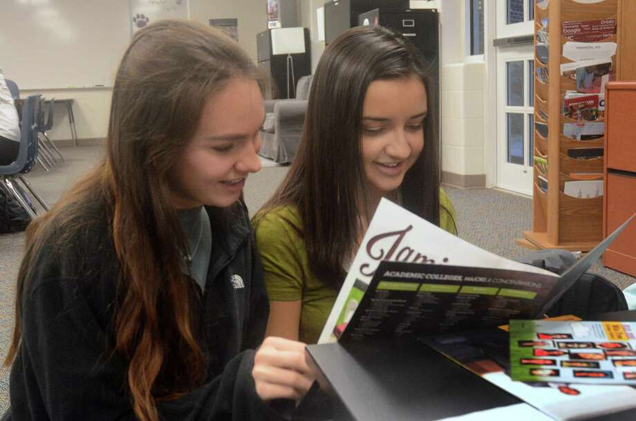 Seniors Kellie Collier and Kate Roberts examine a college information brochure in the college and career center at College Park High School. Photograph by David Hopper Photo: David Hopper, Freelance / freelance