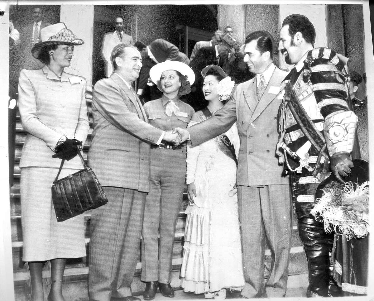 The Portola Festival tour was greeted in New York by mayor William O'Dwyer (l to r) Mrs. Marvin Lewis, Festival Queen Anne Bucher, Festival Princess Diane Shinn, Supervisor Marvin Lewis, and Mike Desiano as Don Gaspar de Portola
