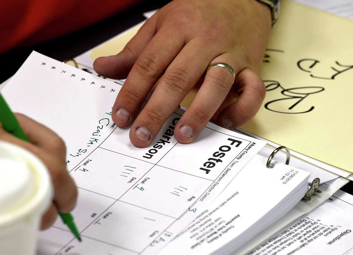 FILE. Showing a vote count during a local vote canvas like what will be happening across the country in the weeks to come as the 2020 election results are certified. (Skip Dickstein/Times Union)