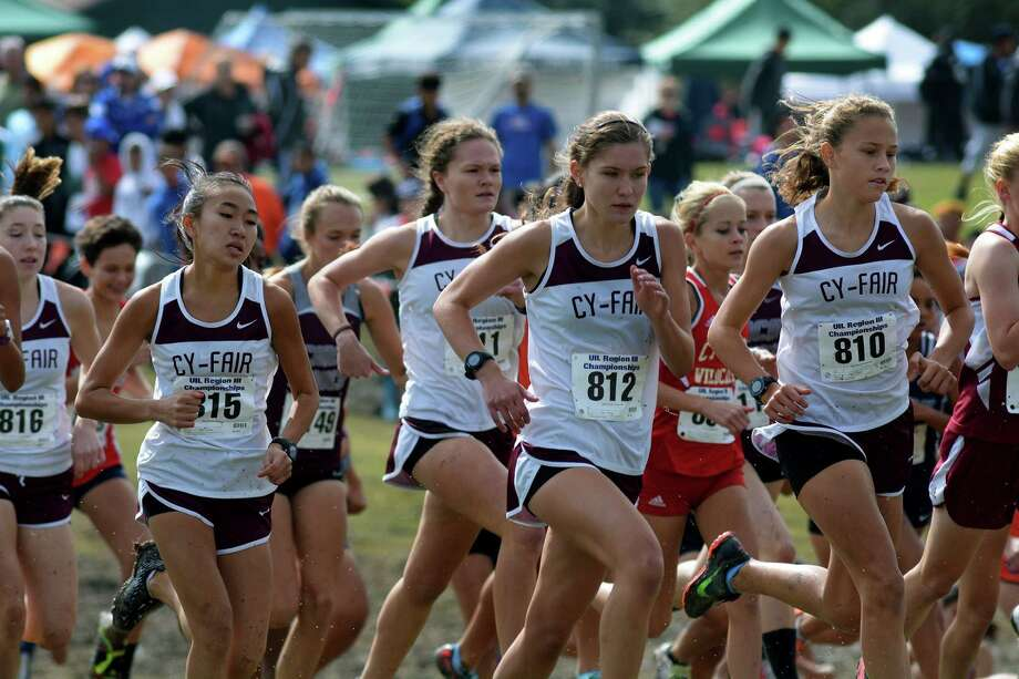 Cy-Fair freshman Jordan Barnhart (810), followed by senior teammates Rebecca Bonta (812), and sister Rachel (811) and junior Tyra Luong (815) and the rest of the Bobcat squad finished fifth in the UIL Class 6A Cross Country Tournament last weekend. Photo: Jerry Baker, Freelance