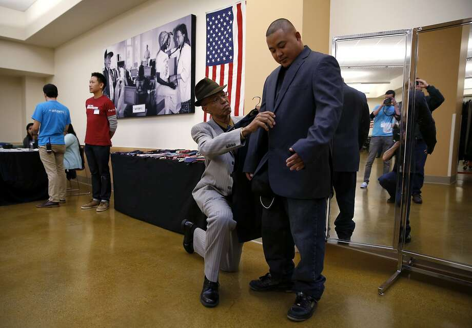 Del Seymour adjusts Mixon Matignas' new jacket during an event to help veterans at the St. Anthony Foundation in San Francisco on Tuesday, Nov. 10, 2015. Photo: Connor Radnovich, The Chronicle