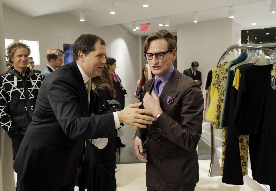 Drew Altizer chats with Hamish Bowles, right, during the opneing night party for Marni Boutique in San Francisco, Calif., on Wednesday, November 4, 2015. Drew Altizer has become San Francisco's top society photographer,  people try  hard to get their photos taken by him, so they can be seen in newspapers, magazines and online posts. Photo: Carlos Avila Gonzalez, The Chronicle