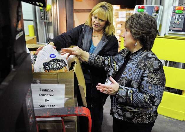 Christina Rajotte of Equinox. left, and Mona Golub from Price Chopper/Market 32 check out turkeys for the 2015 Equinox Thanksgiving Day Community Dinner being loaded at Price Chopper's Frozen Food Distribution Center Tuesday Nov. 10, 2015 in Rotterdam, NY. Price Chopper and Market 32 are donating all of the turkeys needed for the 2015 Equinox Thanksgiving Day Community Dinner – more than six tons worth.  (John Carl D'Annibale / Times Union) Photo: John Carl D'Annibale / 00034158A