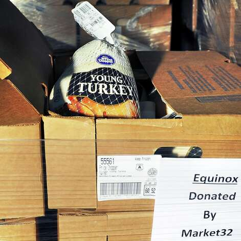 Frozen turkeys loaded into a truck bound for Equinox at Price Chopper's Frozen Food Distribution Center Tuesday Nov. 10, 2015 in Rotterdam, NY. Price Chopper and Market 32 are donating all of the turkeys needed for the 2015 Equinox Thanksgiving Day Community Dinner Ð more than six tons worth.  (John Carl D'Annibale / Times Union) Photo: John Carl D'Annibale / 00034158A