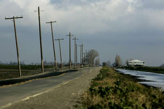 The levee road on Bacon Island  after the delta waters of the adjacent Jones Tract burst through a 400 foot stretch of the levee in 2005  Chronicle Photo by Kat Wade