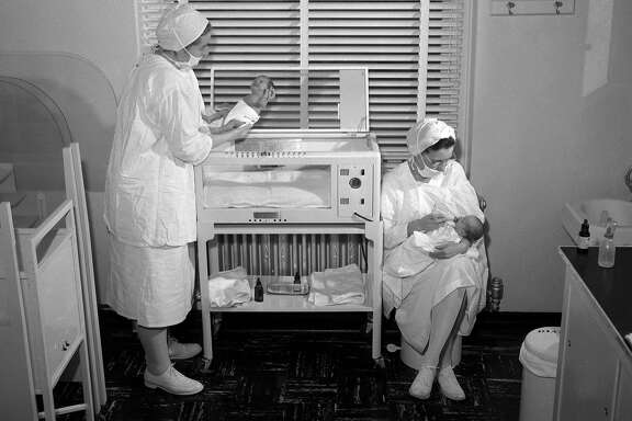 Nurses take care of babies at Mount Zion Hospital, Clinic for Dead children Photo shot 08/20/1953
