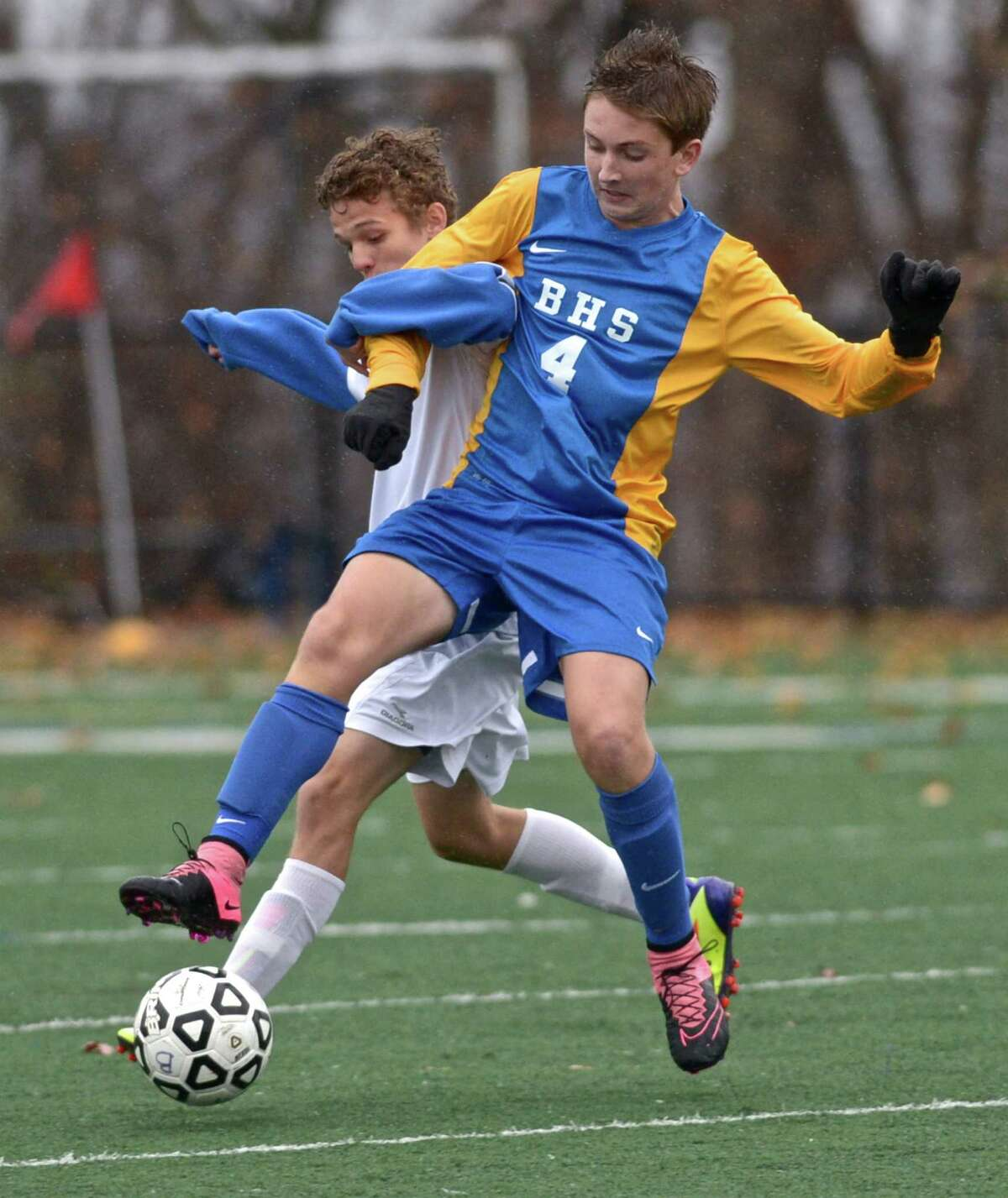 Brookfield's William Lonergan (4) and Abbott Tech's Kassiel Marcelo (2) fight for the ball in the class M boys soccer tournament first round game between No. 22 Brookfield and No. 11 Abbott Tech, On Tuesday afternoon, November 10, 2015, at Broadview Middle School, Danbury, Conn.