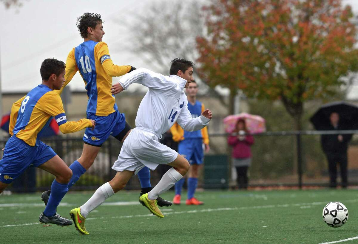 Abbott Tech's Christian Motesdeoca (14) is ahead of Brookfield's Austin DaSilva (10) and Cairo De Souza (8) as they chase down a ball in the class M boys soccer tournament first round game between No. 22 Brookfield and No. 11 Abbott Tech, On Tuesday afternoon, November 10, 2015, at Broadview Middle School, Danbury, Conn.
