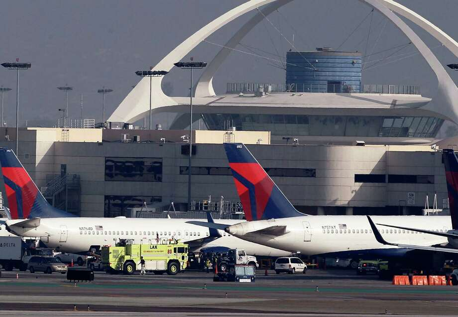 The assets include a 50 percent interest in a pipeline that transports jet fuel to Los Angeles International Airport. Photo: Nick Ut / Associated Press / AP