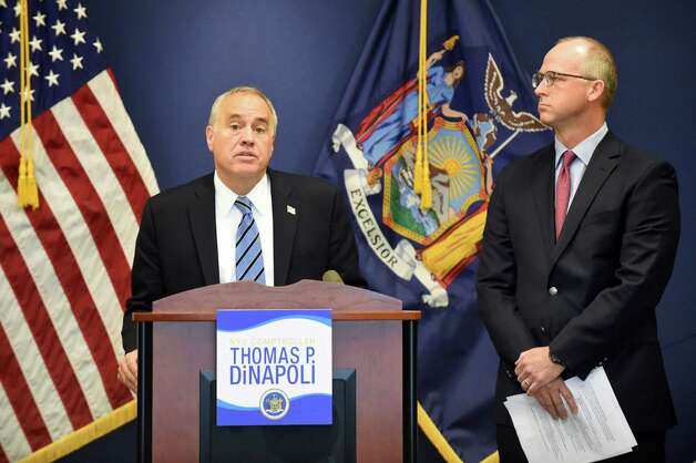 Comptroller Thomas P. DiNapoli, left, and Dave Helgerson, managing director of Hamilton Lane, unveil a new program to offer credit for NY-based businesses on Tuesday, Nov. 10, 2015, at the New York State Comptrollers Office in Albany, N.Y. (Cindy Schultz / Times Union) Photo: Cindy Schultz / 00034169A