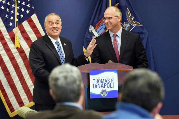 Comptroller Thomas P. DiNapoli, left, share a light moment with Dave Helgerson, managing director of Hamilton Lane, as they unveil a new program to offer credit for NY-based businesses on Tuesday, Nov. 10, 2015, at the New York State Comptrollers Office in Albany, N.Y. (Cindy Schultz / Times Union) Photo: Cindy Schultz / 00034169A