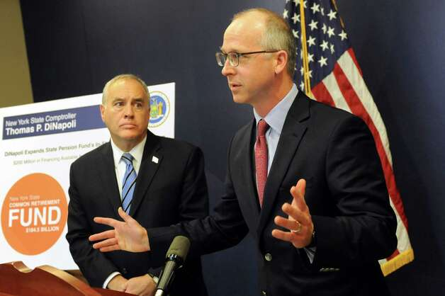 Dave Helgerson, managing director of Hamilton Lane, right, and Comptroller Thomas P. DiNapoli unveil a new program to offer credit for NY-based businesses on Tuesday, Nov. 10, 2015, at the New York State Comptrollers Office in Albany, N.Y. (Cindy Schultz / Times Union) Photo: Cindy Schultz / 00034169A