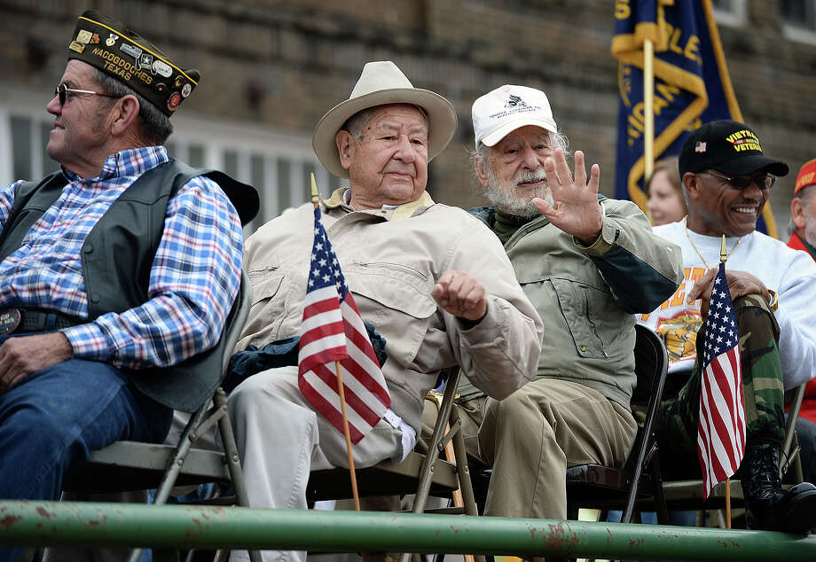 Surviving veterans of several wars and branches of the service ride on one of the floats Saturday, Nov. 9, 2013, in the annual Veterans Parade through downtown Nacogdoches, Texas (AP Photo, The Daily Sentinel/Andrew D. Brosig) Photo: Andrew D. Brosig, MBR / Nacogdoches Daily Sentinel