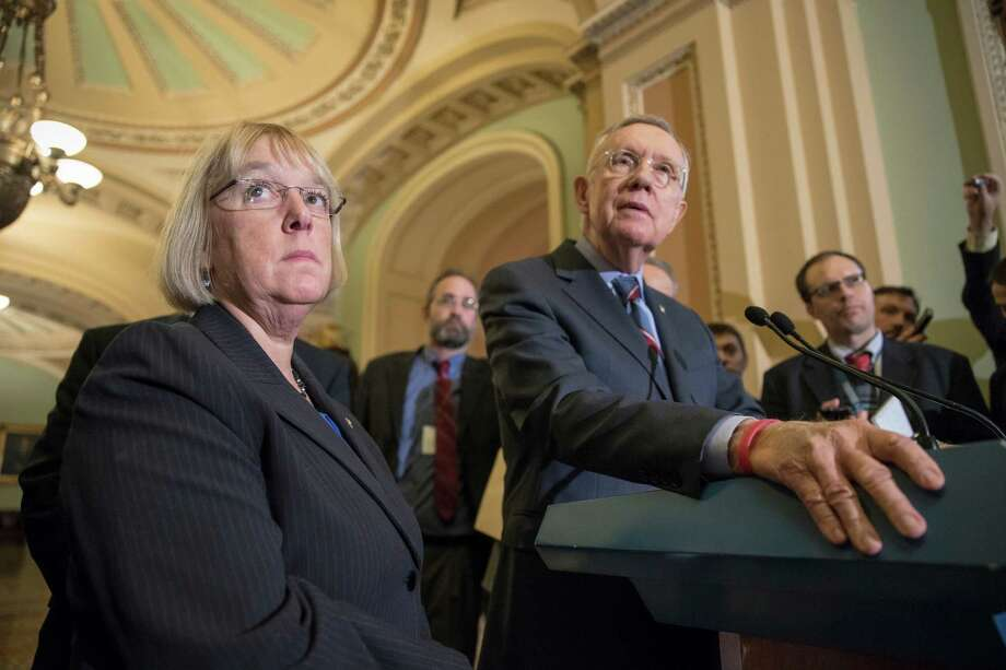 Senate Minority Leader Harry Reid of Nev., right, accompanied by Sen. Patty Murray, D-Wash., ranking member on the Senate Budget Committee, take questions from reporters on Capitol Hill in Washington, Tuesday, Nov. 10, 2015. Congress sent President Barack Obama a $607 billion defense policy bill Tuesday that bans moving Guantanamo Bay detainees to the United States — something Obama has been trying to do since he was sworn in as president.(AP Photo/J. Scott Applewhite) Photo: J. Scott Applewhite, STF / AP