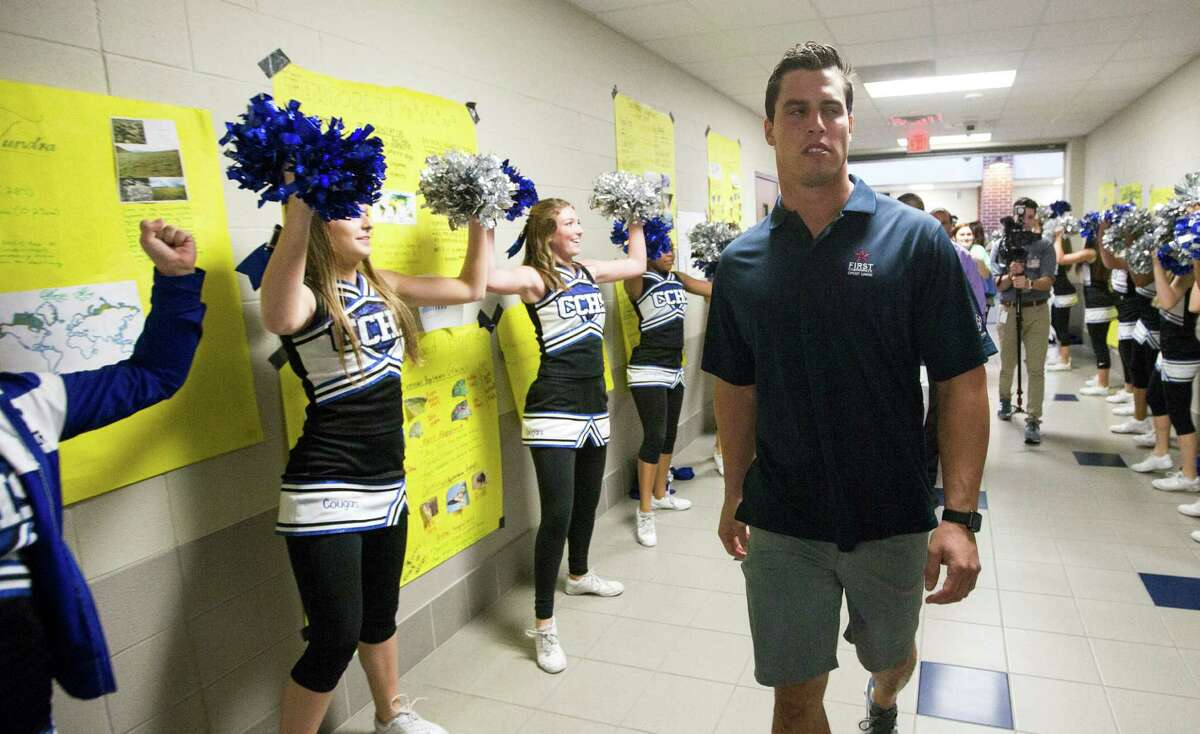 """Houston Texans linebacker Brian Cushing walks down the hallway at Cypress Creek High School to name a pair of Cy Creek teachers (Erin Bryant and Samantha Berry) """"Stars in the Classroom"""" on Tuesday, Nov. 10, 2015, in Houston. First Community Credit Union in partnership with the Houston Texans recognizes 10 deserving Houston area teachers each year through """"Stars in the Classroom."""" Cushing surprised two teachers at Cypress Creek High School, giving each teacher an autographed Texans jersey, and two tickets and sideline passes to a Houston Texans home game. The student who submitted the nomination receives an autographed Texans football. The school district receives a $500 donation in honor of their outstanding teacher."""
