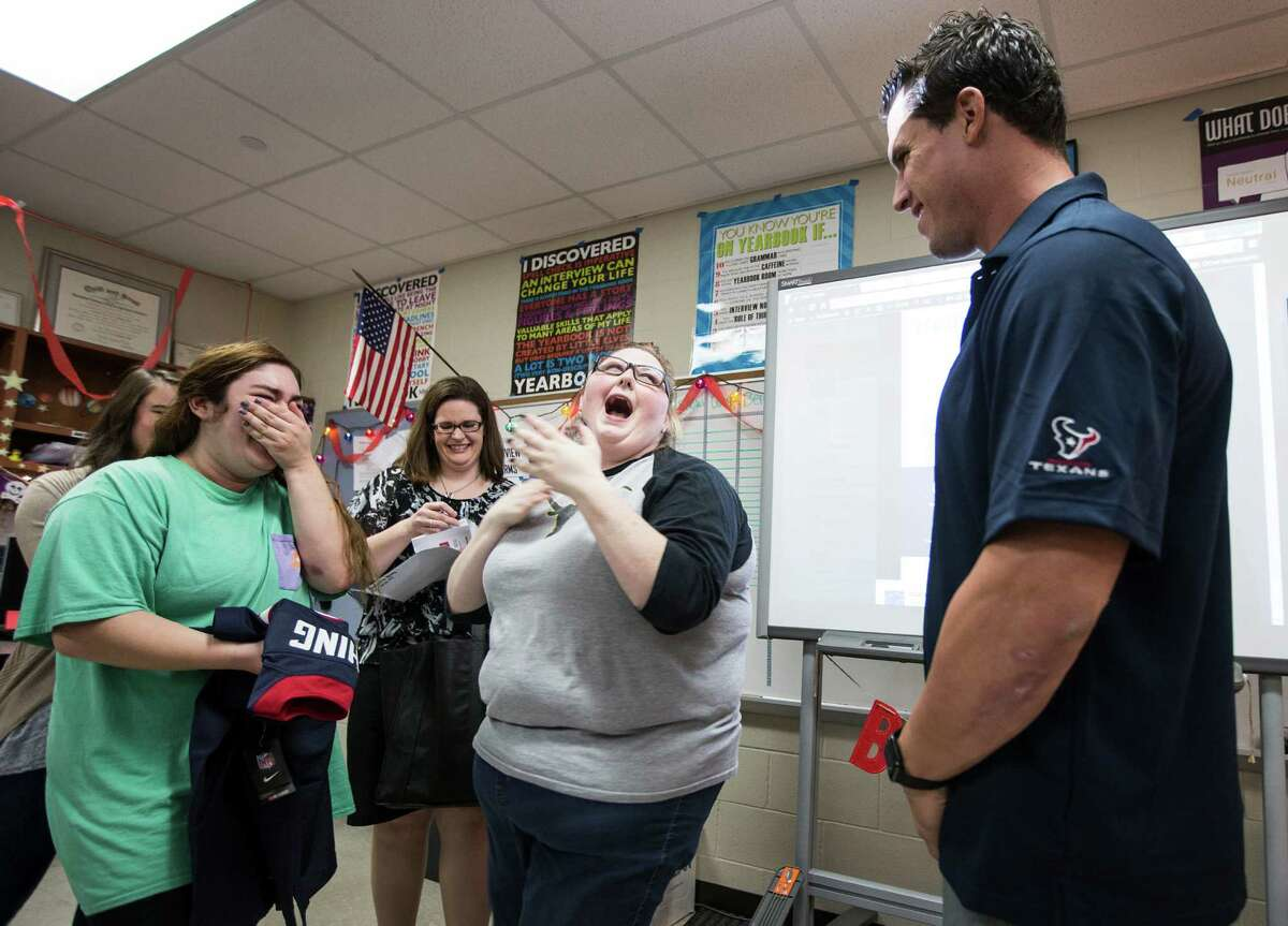 """Cypress Creek senior Chloe Trejo, left, and her journalism teacher Samantha Berry react after being surprised by Houston Texans linebacker Brian Cushing as Berry was named as a """"Star of the Classroom"""" on Tuesday, Nov. 10, 2015, in Houston."""