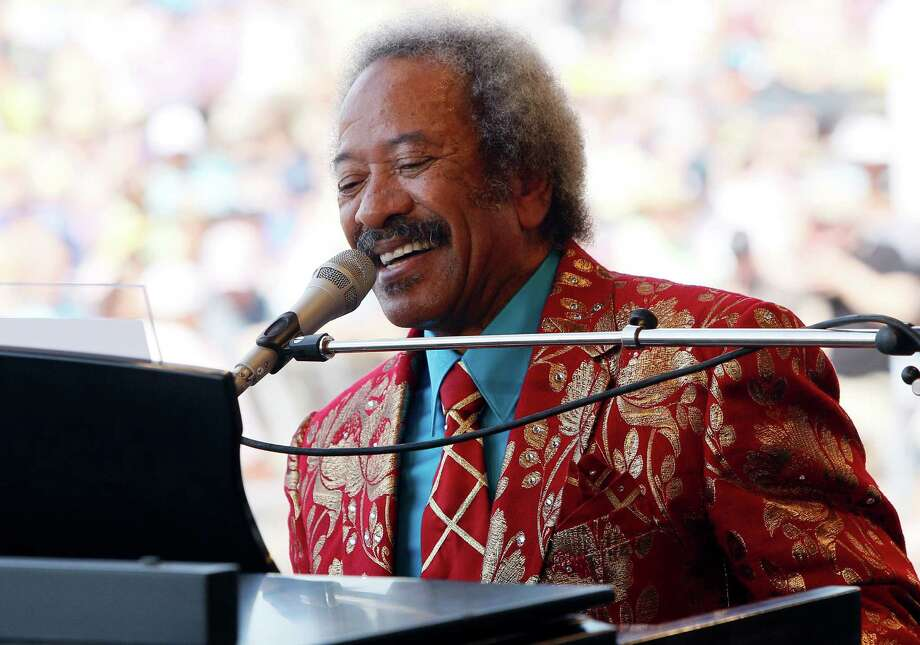 FILE - In this file photo dated Saturday, May 7, 2011, Allen Toussaint performs at theNew Orleans Jazz and Heritage Festival in New Orleans, USA.  Legendary New Orleans musician Toussaint died after suffering a heart attack following a concert he performed in the Spanish capital, Madrid, after emergency services were called Monday Nov. 9, 2015, to his hotel. (AP Photo/Patrick Semansky, FILE) Photo: Patrick Semansky, STF / AP