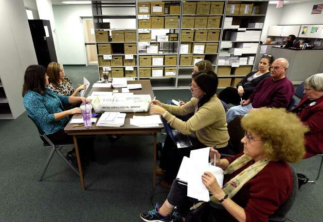 Dorothy Crupe, left, and Joslin Strock canvas votes in the Albany City Council, Albany School Board and the question of building a new High School in the city Tuesday morning, Nov. 10,  2015, at the Albany County Board of Elections offices in Albany, N.Y.  (Skip Dickstein/Times Union) Photo: SKIP DICKSTEIN / 00034161A