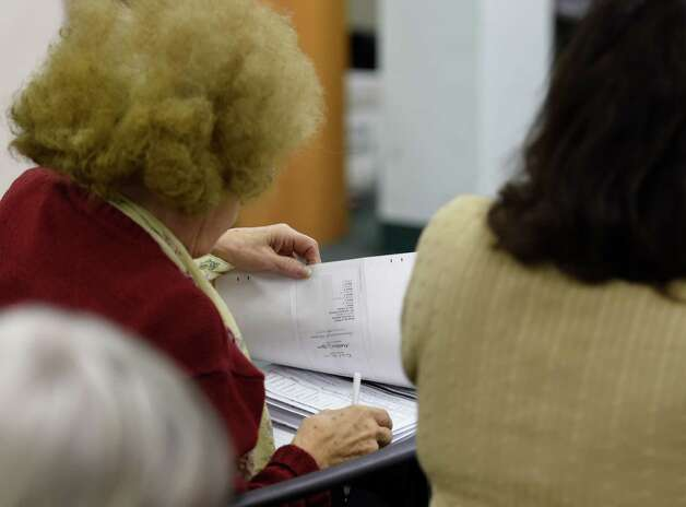 Carol June Washington checks the canvas of votes in the Albany City Council, Albany School Board and the question of building a new High School in the city Tuesday morning, Nov. 10,  2015, at the Albany County Board of Elections offices in Albany, N.Y.  (Skip Dickstein/Times Union) Photo: SKIP DICKSTEIN / 00034161A