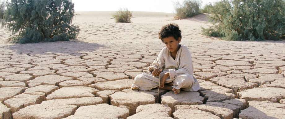 """Theeb (Jacir Eid) gets a brutal survival test in the skillfully made Jordanian spaghetti Western """"Theeb.""""  Credit: Film Movement Photo: Film Movement"""