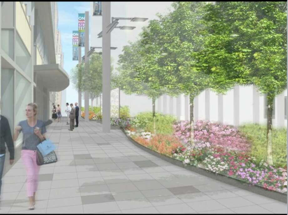 This rendering depicts Main Street after a $12 million improvement project proposed by the Downtown District. Photo: Downtown District