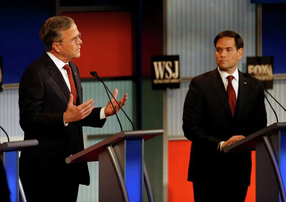 Jeb Bush, left, speaks as Marco Rubio listens during Republican presidential debate at Milwaukee Theatre, Tuesday, Nov. 10, 2015, in Milwaukee. Photo: Morry Gash, AP / AP