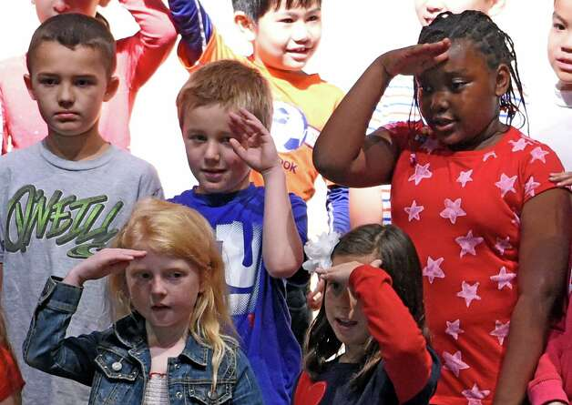 Some students have a little trouble with a salute during the Veteran's Day assembly at the Van Rensselaer Elementary School Tuesday morning Nov. 10,  2015 in Rensselaer, N.Y.  (Skip Dickstein/Times Union) Photo: SKIP DICKSTEIN / 00034013A