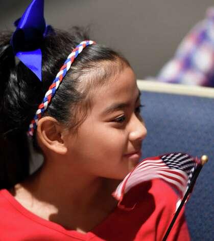 Eisandar Soe, 10 waves an American flag during the Veteran's Day assembly at the Van Rensselaer Elementary School Tuesday morning Nov. 10,  2015 in Rensselaer, N.Y.  (Skip Dickstein/Times Union) Photo: SKIP DICKSTEIN / 00034013A