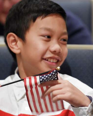 Myoset Pine,  holds an American flag during the Veteran's Day assembly at the Van Rensselaer Elementary School Tuesday morning Nov. 10,  2015 in Rensselaer, N.Y.  (Skip Dickstein/Times Union) Photo: SKIP DICKSTEIN / 00034013A
