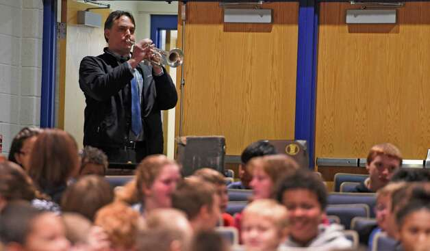 Teacher Robert Hosley gets things started by playing a rendition of Revelille during the Veteran's Day assembly at the Van Rensselaer Elementary School Tuesday morning Nov. 10,  2015 in Rensselaer, N.Y.  (Skip Dickstein/Times Union) Photo: SKIP DICKSTEIN / 00034013A