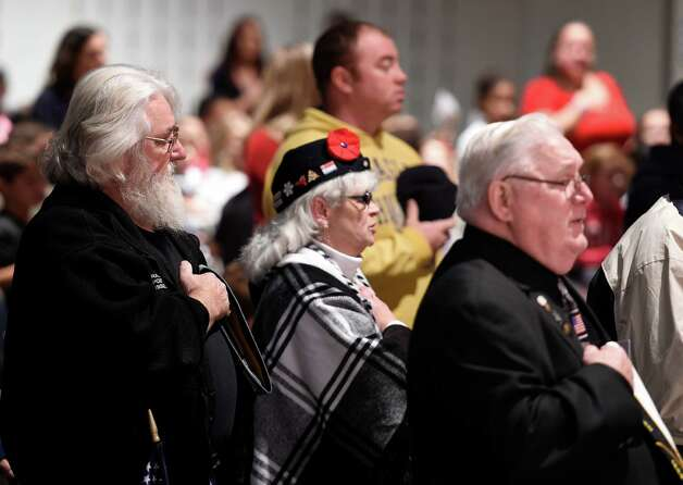 Veterans and their relatives hold their hats on their hearts during the playing of the Star Spangled Banner during the Veteran's Day assembly at the Van Rensselaer Elementary School Tuesday morning Nov. 10,  2015 in Rensselaer, N.Y.  (Skip Dickstein/Times Union) Photo: SKIP DICKSTEIN / 00034013A