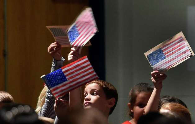 Students show their patriotism during the Veteran's Day assembly at the Van Rensselaer Elementary School Tuesday morning Nov. 10,  2015 in Rensselaer, N.Y.  (Skip Dickstein/Times Union) Photo: SKIP DICKSTEIN / 00034013A