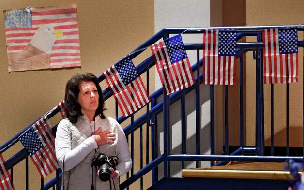A attendee holds her hand over her heart during the playing of the Star Spangled Banner at the Veteran's Day assembly at the Van Rensselaer Elementary School Tuesday morning Nov. 10,  2015 in Rensselaer, N.Y.  (Skip Dickstein/Times Union) Photo: SKIP DICKSTEIN / 00034013A