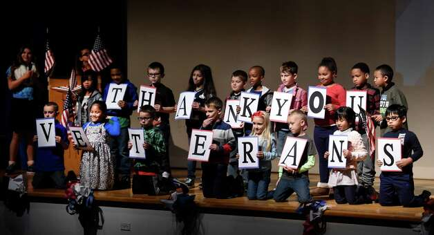 Students show their appreciation of the veterans during the Veteran's Day assembly at the Van Rensselaer Elementary School Tuesday morning Nov. 10,  2015 in Rensselaer, N.Y.  (Skip Dickstein/Times Union) Photo: SKIP DICKSTEIN / 00034013A