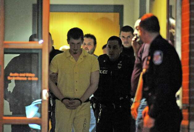 Michael Chmielewski, center, and Sean Moreland, back center, are lead out of Colonie Town Court after being arraigned for the killing of Jacquelyn Porreca on Tuesday Nov. 10, 2015 in Colonie, N.Y.  (Michael P. Farrell/Times Union) Photo: Michael P. Farrell / 00034179B